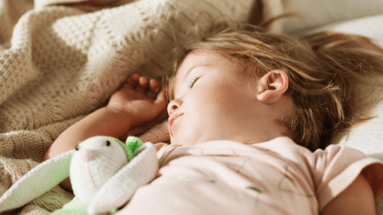 little girl sleeping with stuffed bunny | Tender Transitions