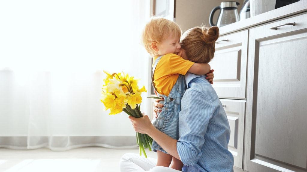 Toddler hugging Mom - Tender Transitions